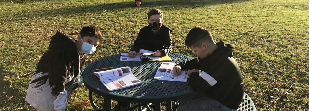 middle school students study outside