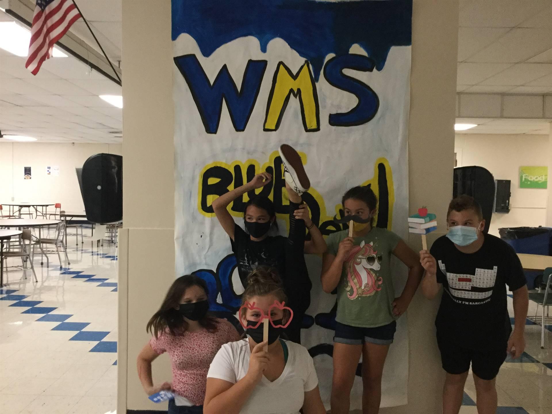 Five children in front of WMS Blue Devils 2021 sign