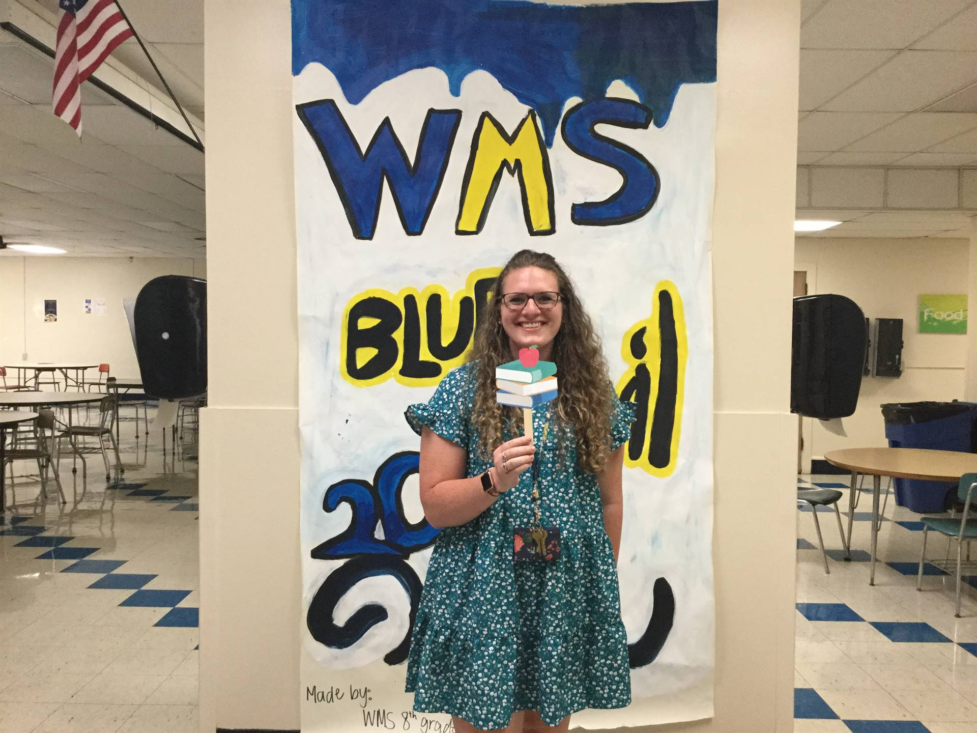 One adult in front of WMS Blue Devils 2021 sign